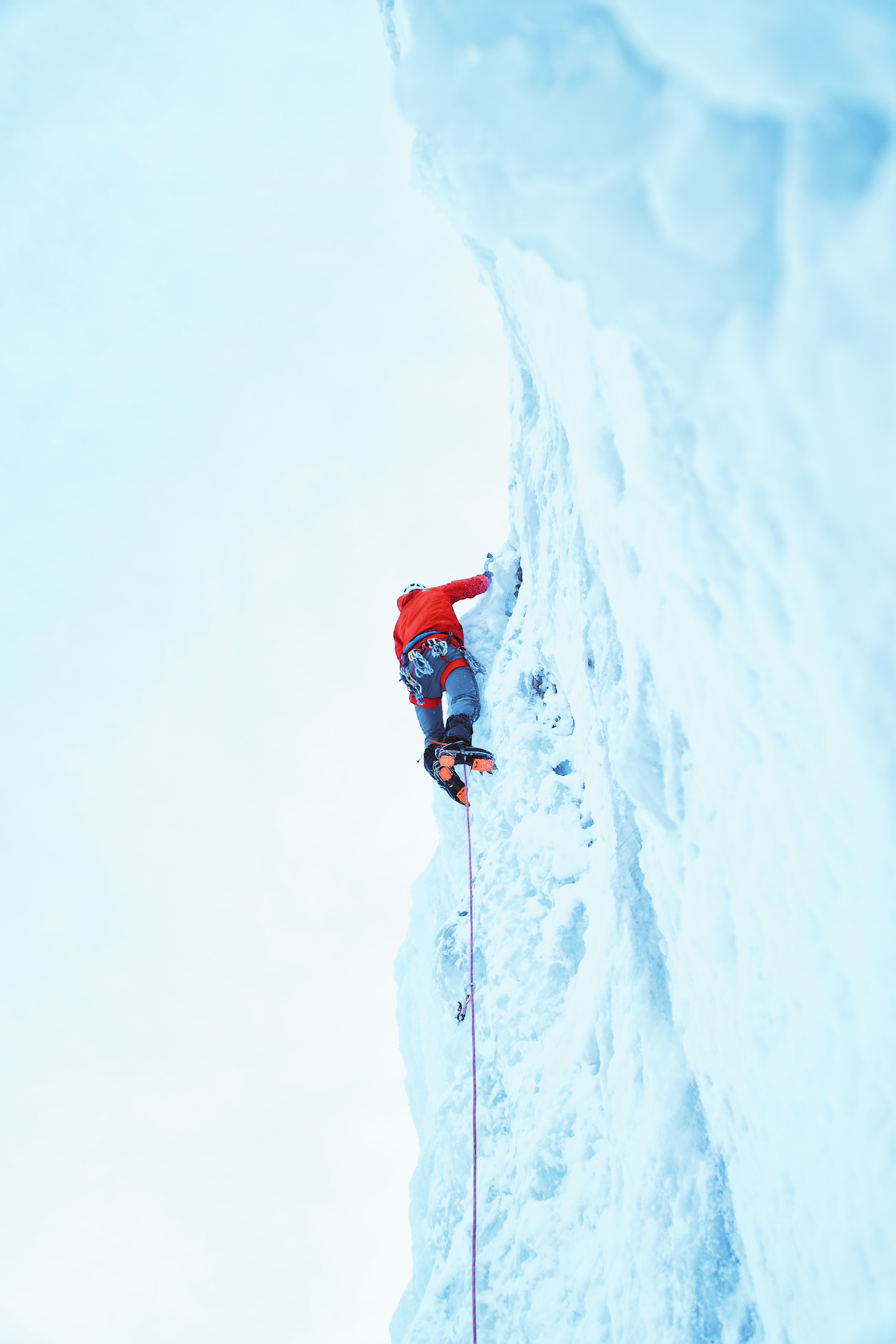 Man climbing an icy wall