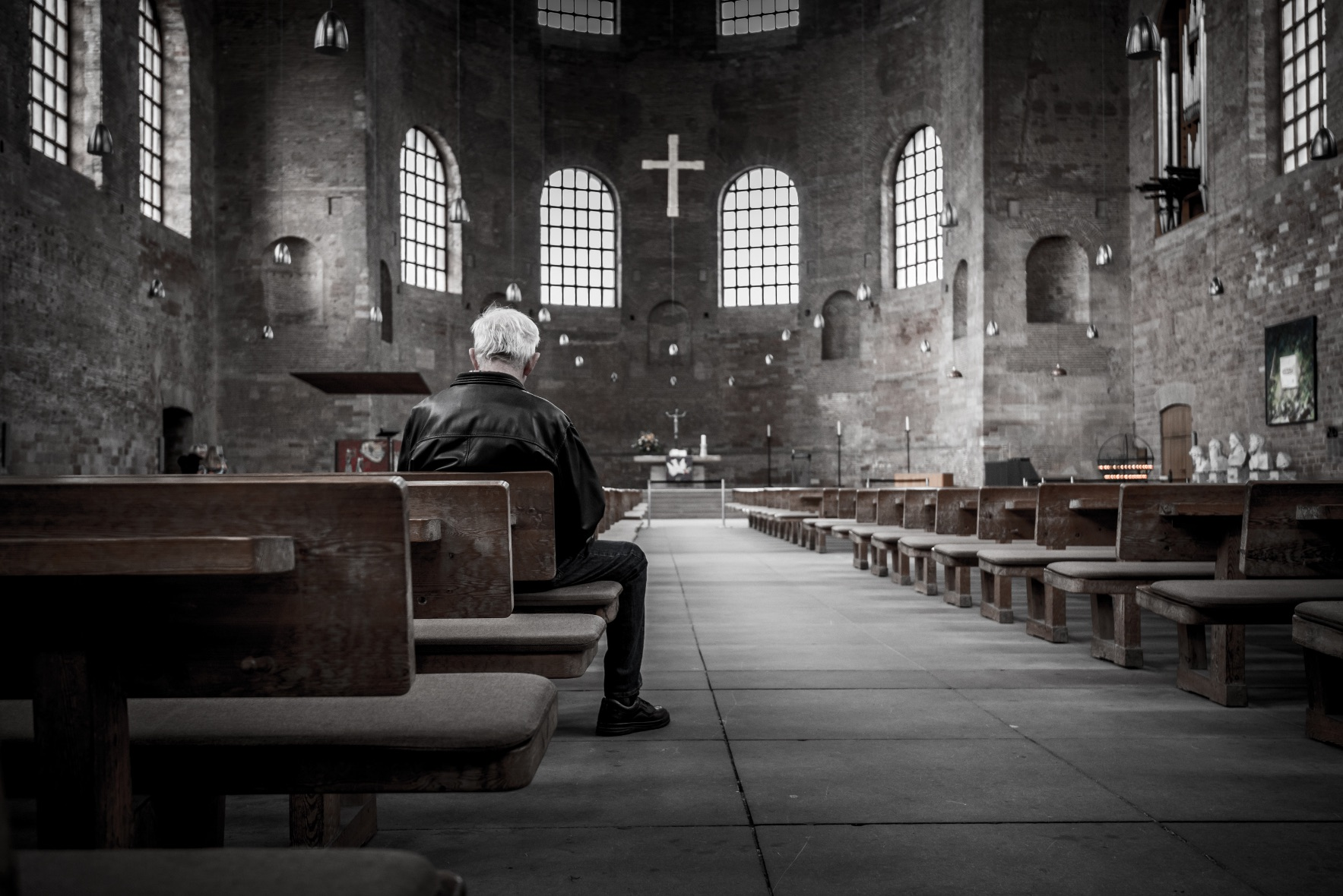 Man sitting in an empty sanctuary